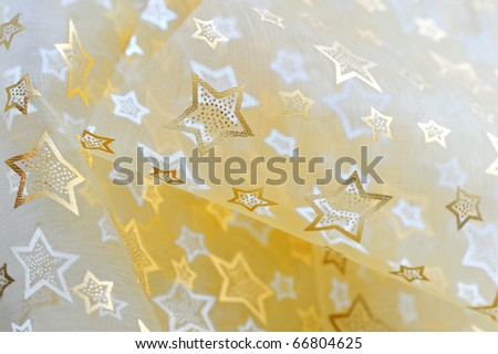 Golden stars on cloth background