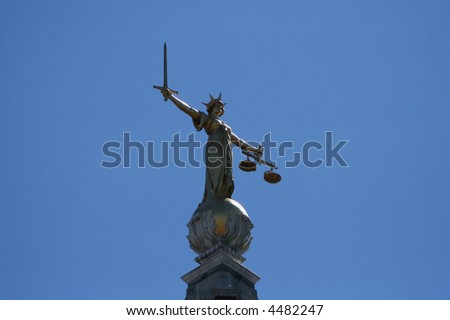 golden statue at Old Baily criminal court, London