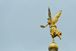 golden statue of Muse on top of Academy of Arts in Dresden, Germany