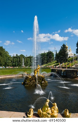 golden statue of Samson on small stone island in lower park of Peterhof. Saint Petersburg. Russia