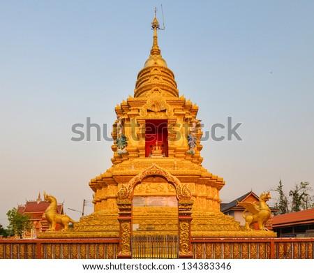 Golden stupa in Thailand, Buddha religion sign.