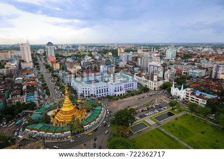 Golden Sule Pagoda in the central business district of Burma, Yangoon during the day from bird eye view. stock photo