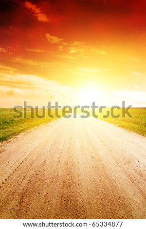 Golden sun in evening time above the field - stock photo