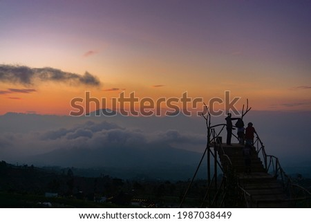 Golden sunrise at Mangli Sky View on the slopes of Mount Sumbing, Magelang, Central Java, Indonesia Stock fotó ©
