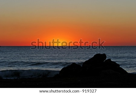 Golden Sunrise on beach in Marbella southern Spain