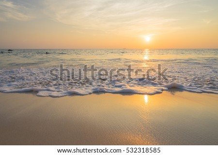 Golden sunrise sunset over the sea ocean waves #532318585