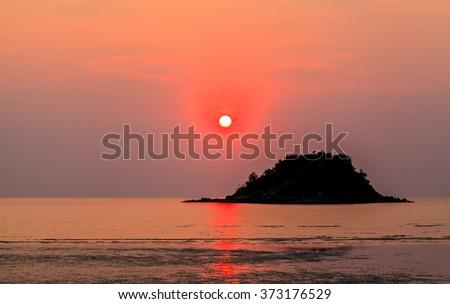 Golden sunset on beach #373176529