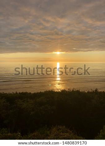 Golden sunset over a glistening ocean.