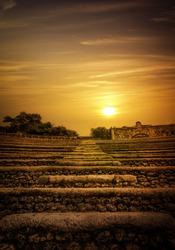 Golden sunset over antique steep stony steps