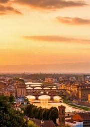 Golden sunset over the river Arno and Ponte Vecchio, Florence, Italy