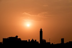 Golden sunset with sun and silhouette of mosque & trees Jeddah Saudi Arabia