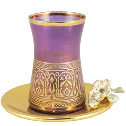 Golden tea cup on saucer for Islamic Muslim holidays decoration Ramadan decoration. Isolated on white background