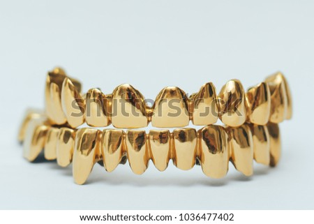 Golden teeth grillz