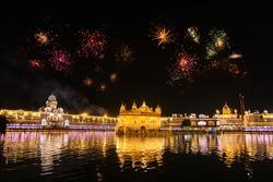 Golden Temple Amritsar lit by Diya and fire crackers Guru Purab festival and Diwali