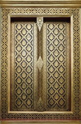 Golden Thai arts on church door at Thailand temple. Traditional Thai style painting pattern.