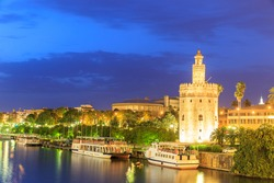 Golden Tower (Torre del Oro) of Seville, Andalusia, Spain over river Guadalquivir at sunset