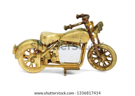 Golden toy old Motorcycle Bigbike isolated on white background. This has clipping path #1336817414