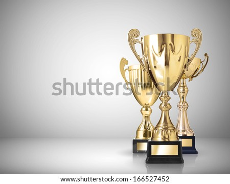 golden trophies on gray background