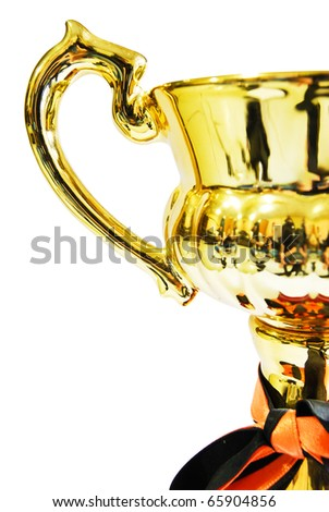 Golden trophy closeup isolated on white background