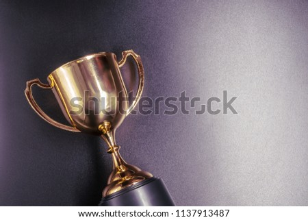Golden trophy on black background #1137913487