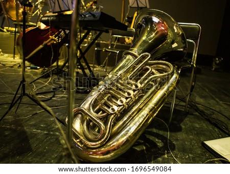 Golden tuba lies on stage Сток-фото ©