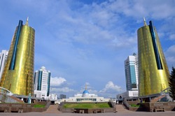 Golden twin towers of the House of Ministries in Astana, Kazakhstan