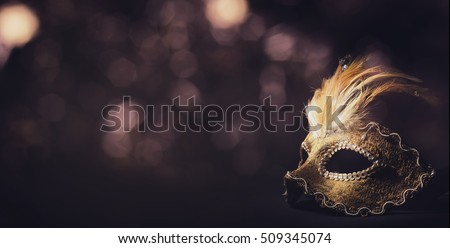Golden venetian ball mask in front of the night bokeh lights. Masquerade party or holiday event celebration concept.  Stock photo ©