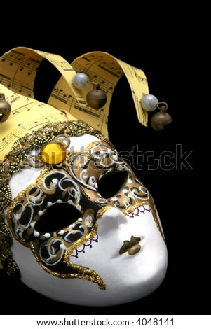 Golden Venetian mask, on black.