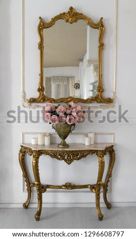 Golden vintage vanity mirror and golden table