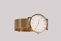 golden watch clock on white background