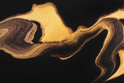 Golden wave zigzag on black. Abstract liquid marble background or texture. Acrylic Fluid Art