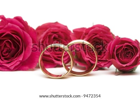stock photo golden wedding rings with flowers