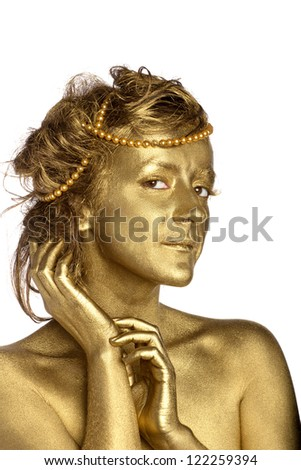 Golden woman with pearls. Isolated on white. - stock photo