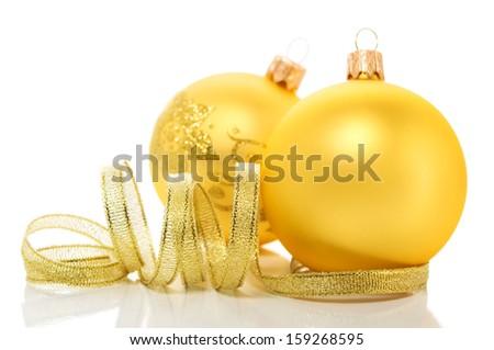 Golden xmas (christmas) ornaments on white background