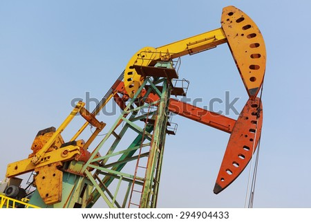 Golden yellow and red Oil pump oil rig energy industrial machine for petroleum crude