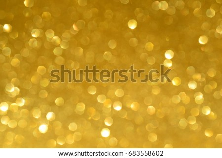 golden yellow blurred bokeh light abstract background for party new year or christmas celebration