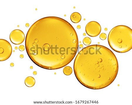 golden yellow bubble oil or serum isolated on white background