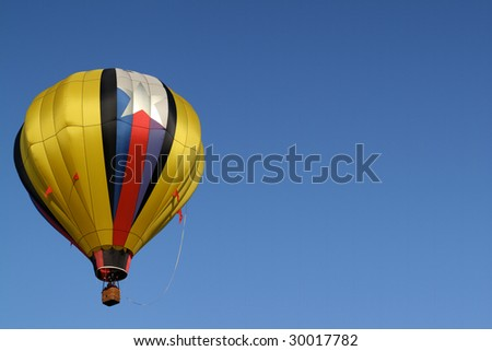 Golden Yellow Hot Air Balloon Rises