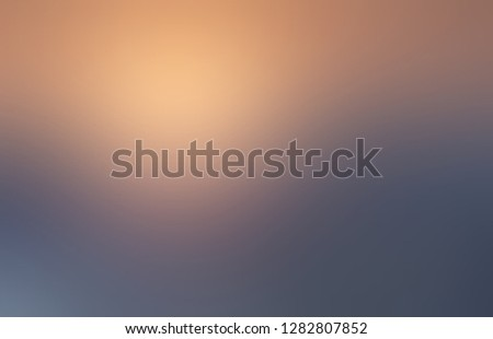 Golden yellow light and muted blue shadow background. Ombre pattern. Cloudy sky blurred texture. Hipster style abstract backdrop. Defocus illustration.