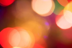 Golden yellow orange green and red Christmas lights bokeh, are abstract, used to represent the celebration of Christmas on a festive and fun holiday. (For use background), (dreamy effect edit)