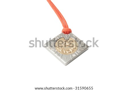 Golden zodiac cancer medallion isolated over white background
