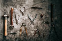 Goldsmith tool on a stone background
