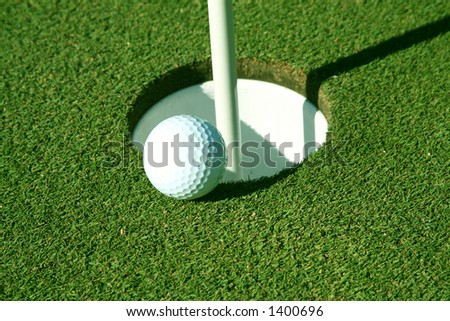 Golf ball about to go in hole, space on ball for logo