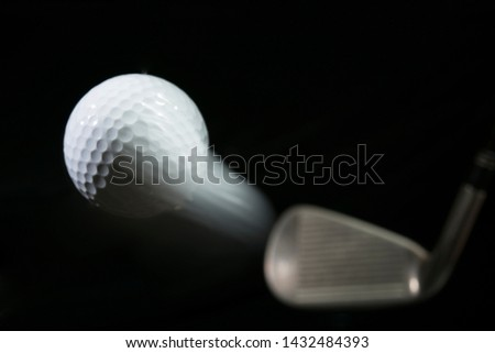 golf ball after teeing off with trail behind