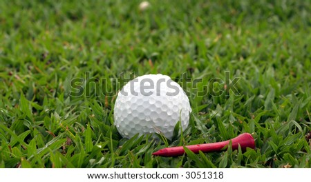 Golf ball and a Red Tee