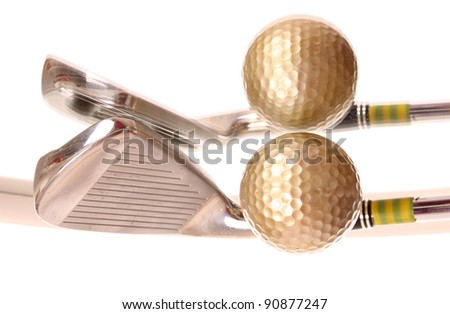 Golf ball and club laying on a mirror