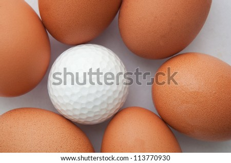 golf ball and fresh egg creative for sport idea