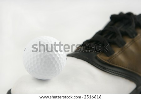 golf ball and golfing shoe, great for backgrounds