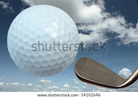 Golf ball and iron against a cloudy blue sky