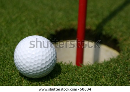 Golf Ball and Practice Putting Hole